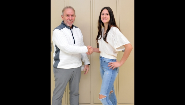 """MADELINE BAKER is congratulated by Assistant Principal Duane VanDrese on being selected as High School Student of the Month for September. In nominating Madeline, Mr. Penberthy said, """"Maddy  is an ultra dedicated student athlete.  She is constantly striving for improvement especially in the classroom.  She often works through lunch, participates often and is inquisitive on a daily basis.  Maddy is aware of personal goals and aspirations.  She is a fine addition to the Pinconning School district."""""""