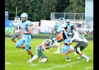 JOHN NORMAN (#14) makes one of his 8 tackles in Friday's 44-0 loss to Meridian.                 --Journal Photo