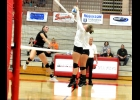VIRGINIA BERGER (#4, above) successfully blocks the Beaverton kill attempt in last Wednesday's match against the Beavers.  --Journal Photo