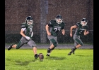 ANTHONY CHARBONNEAU (#8) kicks off for Friday night's game against Shepherd as the persistent rain falls.  --Journal Photo
