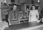 Harry and Marie Bennett stand behind the counter of the Bennett Cheese Store in 1946.  A very different look than we see in food service stores today. Note the open blocks of cheese and the $.49 price tag.                                                                                                                                  --Courtesy Photo from Marcene Brazeau