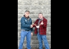 DEAN FENWICK (left) CONGRATULATES WAYNE SETLAK, winner of the Tubular Metal Systems Big Buck Contest for 2019.   --Journal Photo
