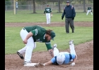 BROC BODRIE (#30) makes the tag to pick off the runner at first.	 --Journal Photo