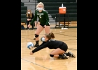 BROOKE LAVRACK (#6) goes for a dig as Alaina Backus (#5) looks on in last Thursday's 3-0 win against Carrollton.			           --Journal Photo