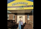 George (Doc) and Dorothy Beuchle are seen in front of the Pinconning Community Center where they hope their Challenge Grant will generate additional funds to renovate the historic building.                                                 --Courtesy Photo