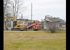 A HOUSE AT 2925 HUPTER RD that suffered a fire on September 14th, was demolished last week. The cause of the fire in the unoccupied house was determined to be electrical, and the structure was a total loss according to the owners, who plan to rebuild next year.                --Journal Photo