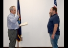 ANDREW MORRIS (right) takes the oath of office as Pinconning's Mayor administered by City Manager/Clerk Bob Moffit after Monday's City Council Meeting. Morris defeated Vern Little and sitting Mayor Gerald Gibson in the November 3rd General Election.       --Journal Photo