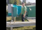 Jim Bouckeart, City of Pinconning Waste Water Treatment Plant employee, is seen painting one of the sewer lift stations within the City.  All three lift stations will be painted in the near future.         --Courtesy Photo