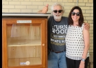 Mike duranczyk and jennifer delorge are shown above with the new Little Free Library at Central elementary.