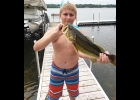 Brothers (l to R) Skyler Pomaville, Ethan Hunt, and Luke Pomaville were fishing near Hale, MI with family and caught these large mouth bass. Skyler age 11, Ethan age 10 and Luke age 5 proudly  display their catch for the camera.                        --Courtesy Photo