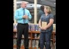 superintendent michael Vieau congratulates Colleen Eigner on her Spartan Spotlight Award.  --Journal Photo