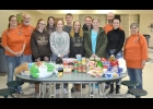 Pinconning High School NHS members and the Great Lakes Outdoorsman Foundation are shown with the food items for one family's food prior to delivery     --Courtesy Photo