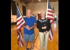 Dennis Whitney and Lorie Szyperski pose with two of the renovated American Flags to be displayed on City of Pinconning light posts.      --Courtesy Photo
