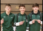 COUNTY CHAMPS! The Pinconning Spartans claimed three Bay County Championships on Saturday, December 21st. From left: Jacob Brooks, 160 lbs; Tristan Dycewicz, 140 lbs; and Tyler Brooks, 135 lbs. Last year, Jacob Brooks captured the 135 lb class that younger brother Tyler won this year. This is Dycewicz' fourth consecutive County Championship, a first for Pinconning.  --Courtesy Photo
