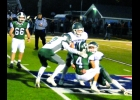 ARTHUR DENNISON (#88) wraps up the Clare runner and Dakota Maes (#2) and Jack Boettcher (#10) come in to assist, early in the Spartans Friday road loss to the Pioneers, by a score of 42-0.                     --Journal Photo