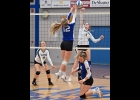 GEENA GAUTHIER (#7) battles the Gladwin player for control of the ball at the top of the net in Pinny's 0-3 loss to the Flying G's last Wednesday.     --Journal Photo