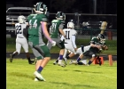 JACK BOETTCHER (#10) goes down but gets the ball across the goal line for Pinconning's only touchdown in their 6-43 loss on Friday.  --Journal Photo