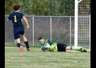 JACOB REDER (#1) steals another potential goal by SSC last Tuesday. Reder's 12 saves were key to Pinconning's 2-1 win.				 --Journal Photo