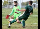 JAMES WUOLUKKA (#7) gets robbed by the Braves keeper in the Spartans 4-3 loss on Thursday.           --Journal Photo