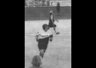 JENNY MACKSON approaches third base during her state championship-winning home run while Wyoming Rogers shortstop and fielder walk off the field   --Journal Photo and caption from June 21, 2000