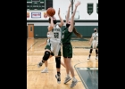 """JORJA GAUTHIER (#22) led the Spartan Girls Varsity with 8 points in their season opening loss to the Clare Pioneers, 20-63, at home on Monday evening. It was the first day that competition in Winter """"contact""""sports was allowed in Michigan.      --Journal Photo"""