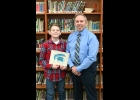 Ryan Kowlaczyk receives his award as Middle School Spartan of the Month for December.  --Journal Photo
