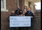 Friends of the Pinconning Community Center are seen as they accept a donation from the Oscar P. and Louise H. Osthelder Advisory Fund at the Bay Area Community Foundation. Pictured are Bob Charlebois, Jessica Holland, Dan Lapan, Dennis Curtis and Ellen Charliebois.                              --Courtesy Photo