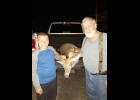 Skyler Pomaville shoots his first buck, a 7 point, with grandpa Leonard Pomaville.          --Courtesy Photo