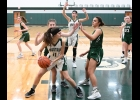 RAVEN WIELAND (#11) battles to make a pass across the lane against the Pioneers. The Spartans came back to win the game 45-32 on Wednesday.  --Journal Photo
