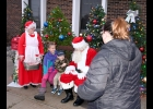 SANTA CAME TO TOWN!!! The Jolly Old Elf came into downtown Pinconning on a firetruck last Wednesday to visit with the children.   --Journal Photo