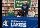 PHS SENIOR LAUREN LAURES signs a National Letter of Intent to continue her basketball career as a member of the Mid-Michigan College Lakers as  (l-r) PHS Coach Mindy Laures, Lakers Coach Matt Rodenbo, and PHS Assistant Coach Bill Laures look on.  --Journal Photo