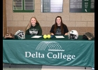 SARAH BARTKOWIAK (left) AND BRENNA HOFFMAN will take the field this year as Seniors with the Pinconning Spartan Varsity Softball Team, but signed on Wednesday to continue their careers next year as Delta Pioneers. The two, Hoffman, the Spartans number one pitcher, and Bartkowiak, starting catcher, have played together for most of their school careers and look to continue the tradition.   --Journal Photo
