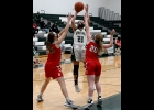 TORI SHARK (#23) fights the Beaverton defense to get the shot away for 2 of her 16 points in the Spartans 35-56 loss to the Beavers last Tuesday.            --Journal Photo