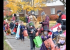 ST MICHAEL STUDENTS trick or treat through the streets of downtown Pinconning on Friday, October 30th.	                                              --Journal Photo by Rachel Floyd