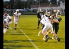 TRISTAN DYCEWICZ (#15) knocks a third Gladwin defender out of his way after catching a Tommy Yanoski pass for an 11-yard gain in Friday's 37-20 Homecoming loss.    --Journal Photo