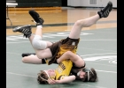 TYLER BROOKS flips his Ogemaw Heights opponent onto his back in last Wednesday's match.				                                      --Journal Photo by Kayla Dybas