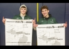 JACOB BROOKS AND TRISTAN DYCEWICZ hold their weight class brackets from the MHSAA Individual Wrestling Regional 9-3 showing each as Champions in their weight class. The two will head to the State Championships at Ford Field on March 6th.