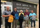 PASD SUPERINTENDENT MIKE VIEAU, Gavin Goetz of AT&T Michigan Pioneers, 98th District State Representative Annette Glenn, 31st District State Senator Kevin Daley, and 96th District State Representative Timothy Beson pose on August 27th with some of the backpacks donated by the AT&T employee group for students in need within the district.                --Courtesy Photo